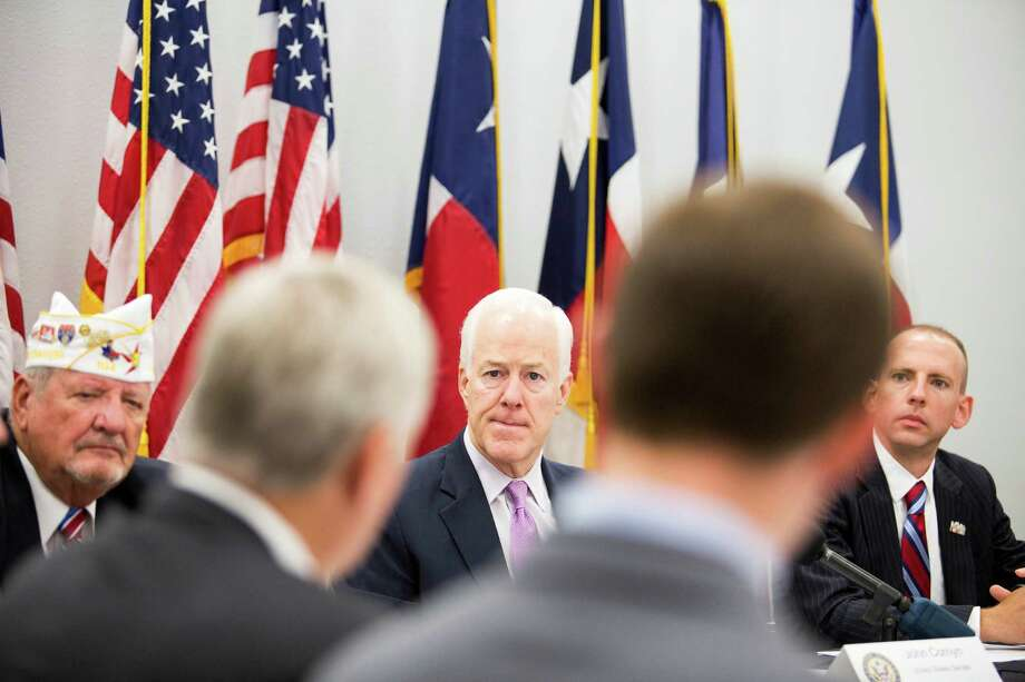 U.S. Sen. John Cornyn, center, meets with a group of veterans Thursday in Houston to hear suggestions for corrective action. Photo: Eric Kayne / Eric Kayne