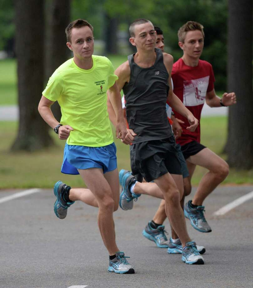 Jay Navin, left leads a run of members of the Saratoga High Scool Cross Country team at practice at the Saratoga Spa State Park Aug 26, 2013 in Saratoga Springs, N.Y.  (Skip Dickstein/Times Union) Photo: SKIP DICKSTEIN