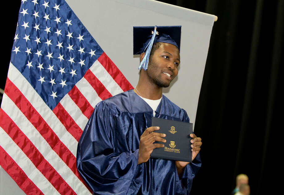Graduate Eric Nesmith holds up his diploma during Housatonic Community College's 47th commencement at Webster Bank Arena in Bridgeport on May 29, 2014. Photo: Amy Mortensen / Connecticut Post Freelance