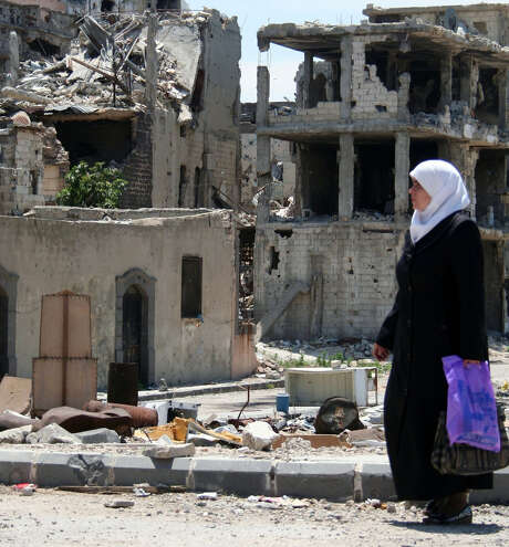 A woman strolls out of the ruins of the Old City of Homs, which was devastated by a Syrian army siege. Photo: McClatchy-Tribune News Service / MCT
