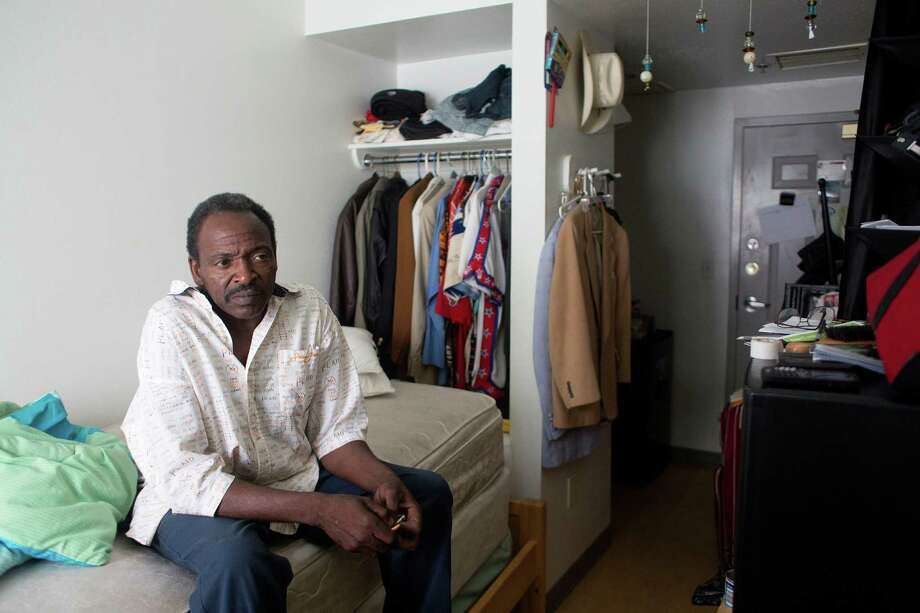 Curtis Randle, 52, who said he was chronically homeless for about eight years, sits in his efficiency apartment in a New Hope Housing, 57-unit building downtown on Thursday. Photo: Johnny Hanson / © 2014  Houston Chronicle