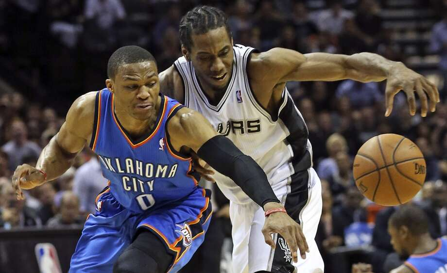 Russell Westbrook steals the ball from Kawhi Leonard after Leonard stole the ball from Kevin Durant as the Spurs play the fifth game of the Western Conference Finals against the Oklahoma City Thunder on May 29, 2014. Photo: TOM REEL
