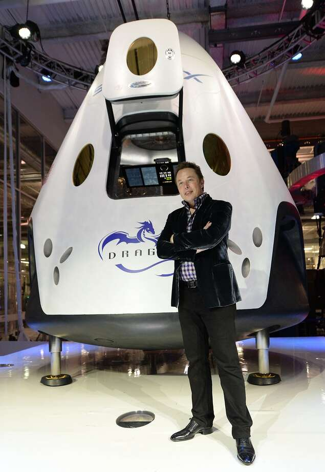 SpaceX CEO Elon Musk introduces the Dragon V2 spacecraft, designed to carry astronauts into space. Photo: Robyn Beck, AFP/Getty Images