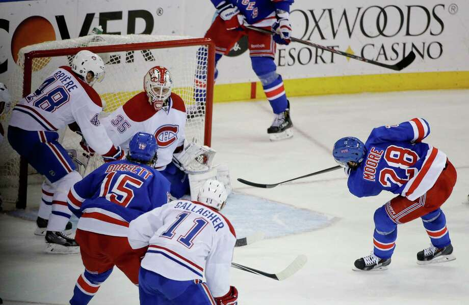 New York Rangers center Dominic Moore (28) shoots to score against the Montreal Canadiens during the second period in Game 6 of the NHL hockey Stanley Cup playoffs Eastern Conference finals, Thursday, May 29, 2014, in New York. (AP Photo/Frank Franklin II)  ORG XMIT: NYJJ114 Photo: Frank Franklin II / AP
