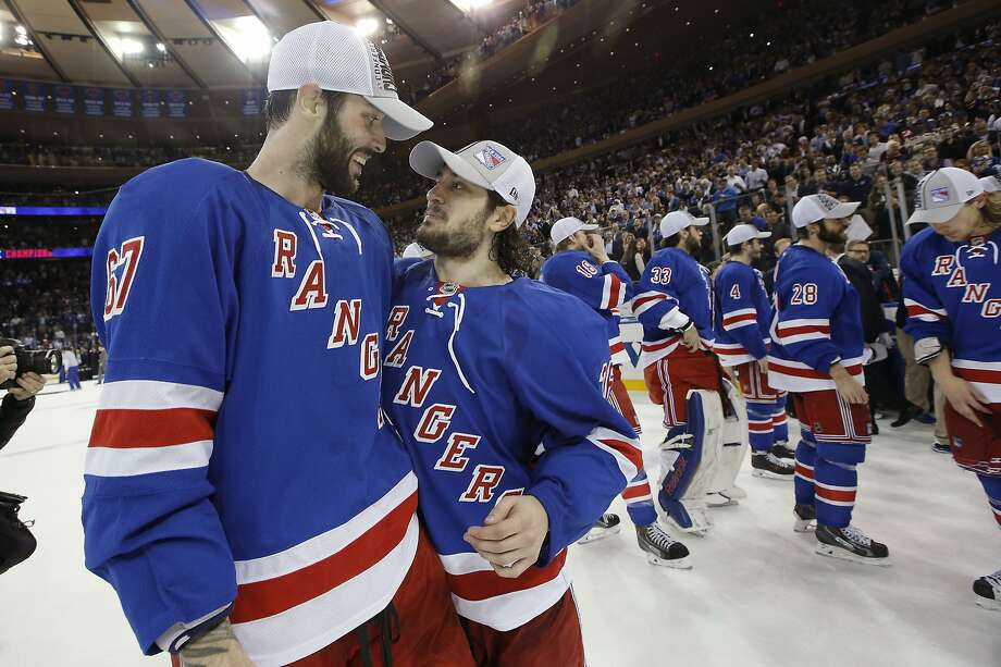 Benoit Pouliot (left) and Mats Zuccarello celebrate after the Rangers earned their first trip to the Stanley Cup Finals in 20 years. Photo: Kathy Willens, Associated Press
