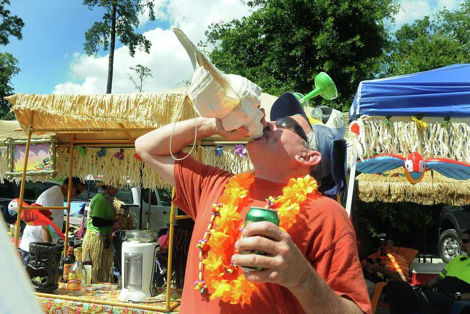 David Bradford, of Liverpool, Tx., blows on a sea shell horn  during the Jimmy Buffett Tailgating Party in the parking lot at Six Pines Drive and Lake Roibbins Drive. Jimmy Buffett performed, for a sold our crowd, at the Cynthia Woods Mitchell Pavilion after the Tailgating Party.  Photo: David Hopper, For The Chronicle / freelance