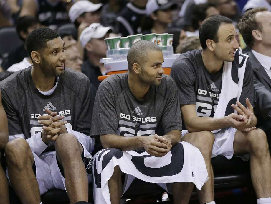 Tim Duncan, Tony Parker and Manu Ginobili watch the conclusion of the Spurs' Game 5 victory over the Thunder. Photo: Eric Gay, Associated Press