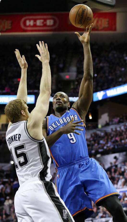 San Antonio Spurs' Matt Bonner defends Oklahoma City Thunder's Serge Ibaka during first half action in Game 5 of the Western Conference finals Thursday May 29, 2014 at the AT&T Center. Photo: Edward A. Ornelas, San Antonio Express-News