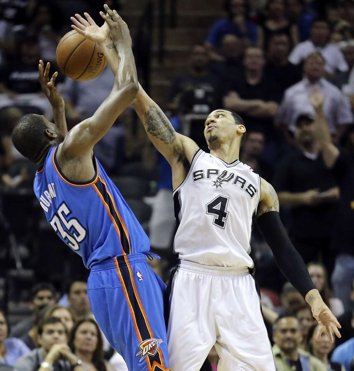 Oklahoma City Thunder's Kevin Durant and San Antonio Spurs' Danny Green grab for a loose ball during second half action in Game 5 of the Western Conference finals Thursday May 29, 2014 at the AT&T Center. The Spurs won 117-89.