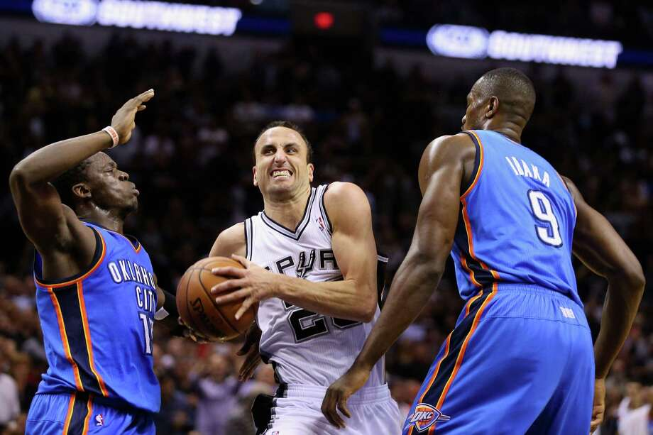 Spurs guard Manu Ginobili splits Reggie Jackson, left, and Serge Ibaka of the Thunder on his way to the rim and 19 points on 7-for-9 field-goal shooting. Photo: Ronald Martinez, Staff / 2014 Getty Images
