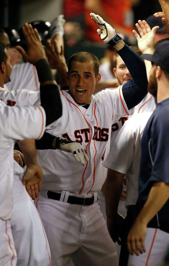 Lefthander Dallas Keuchel, left, and rookie slugger George Springer have been a breath of fresh air for an Astros club still in rebuilding mode after losing 100-plus games in each of the last three seasons. Photo: Karen Warren, Staff / © 2014 Houston Chronicle
