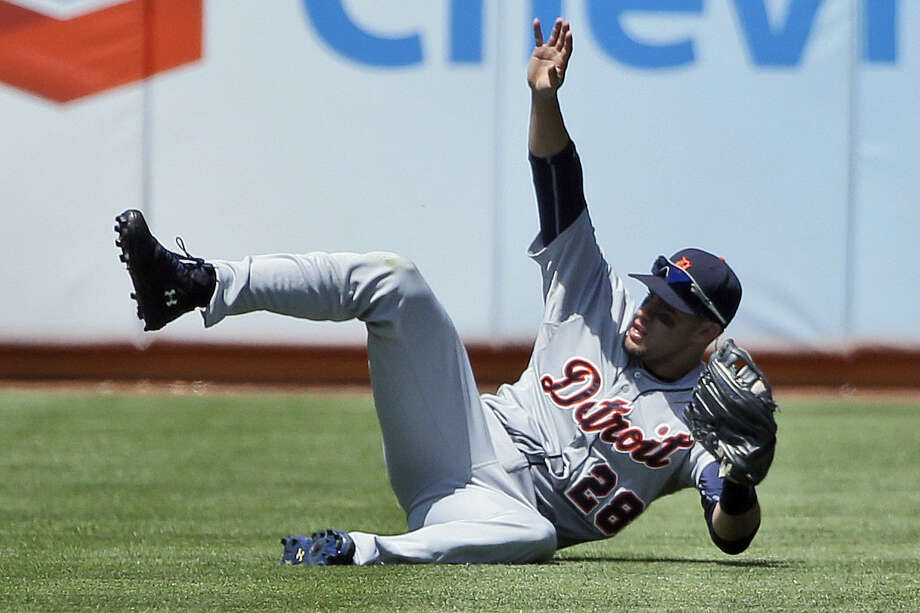 Detroit's J.D. Martinez makes a sliding catch in the fifth inning of the Tigers' victory over the Athletics. Photo: Marcio Jose Sanchez / Associated Press / AP