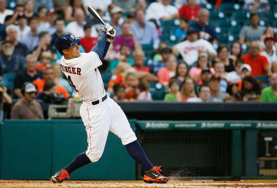 George Springer has had a month to remember. Springer, right, hit a tie-breaking two-run homer in the seventh inning. Photo: Scott Halleran, Getty Images