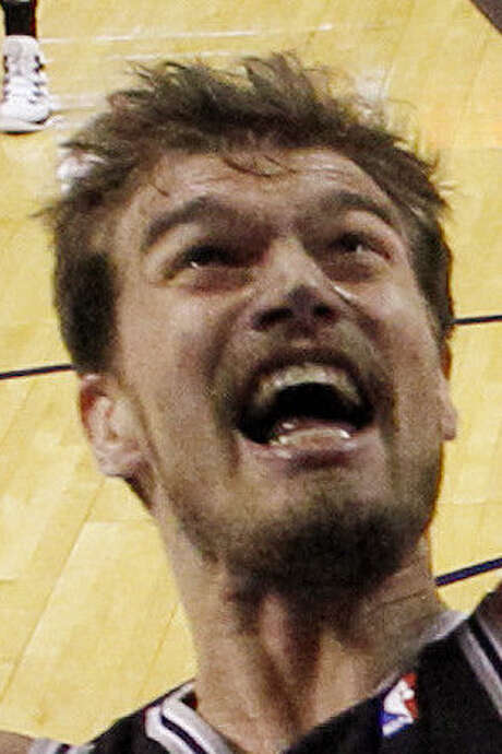 Spurs big man Tiago Splitter was surprised he got fined $5,000 for flopping in Game 4. / AP