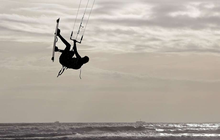 A man is silhouetted in mid air while kitesurfing, at a beach near the city of Cape Town, South Africa, Thursday, May 29, 2014. (AP Photo/Schalk van Zuydam) Photo: Schalk Van Zuydam, Associated Press