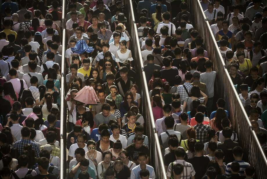 *** BESTPIX *** BEIJING, CHINA - MAY 29:  Chinese commuters line-up at a security check to enter a subway station on May 29, 2014 in Beijing, China. Authorities have increased security in many public areas after an attack last week left 31 dead in the restive Xinjiang Province. (Photo by Kevin Frayer/Getty Images) Photo: Kevin Frayer, Getty Images