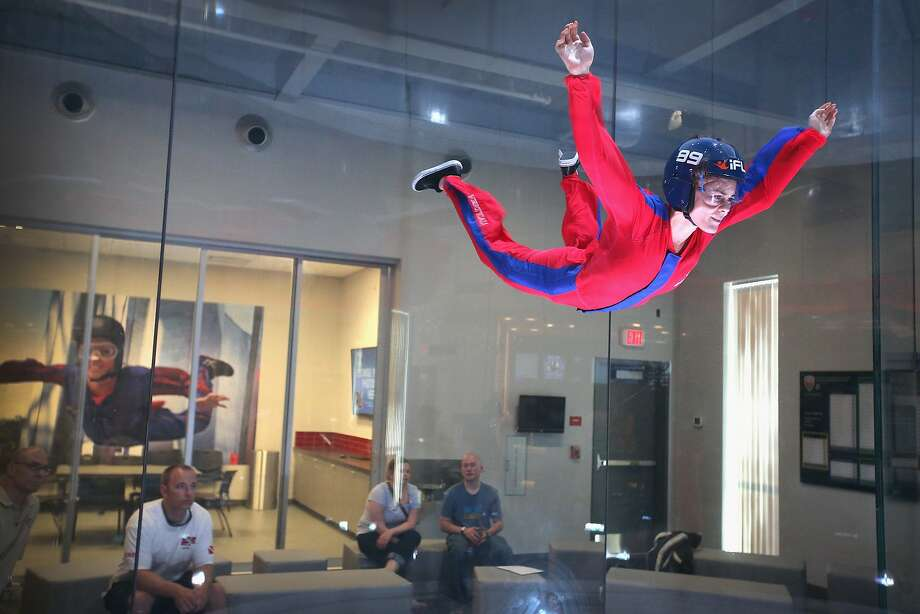 ROSEMONT, IL - MAY 29: Skydiver Lauren Wilkerson practices wind tunnel flying at the iFly indoor skydiving facility on May 29, 2014 in Rosemont, Illinois. Guests at the facility are introduced to the sensation of free-fall skydiving as they are lifted into the air by fans which generate an upward draft from 80 to 175 miles per hour inside a 14-foot-wide circular chamber.  The company operates about 30 similar facilities around the globe which are used for military and competitive skydiver training as well as recreation.  (Photo by Scott Olson/Getty Images) Photo: Scott Olson, Getty Images