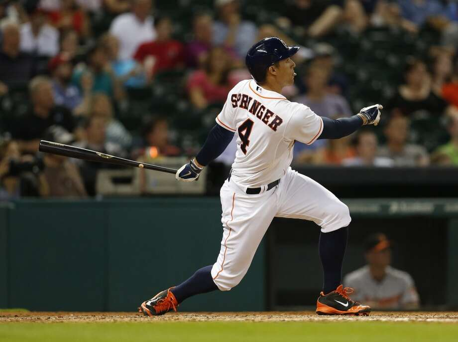 May 29: Astros 3, Orioles 1  Astros right fielder George Springer hits a home run during the seventh inning. Photo: Karen Warren, Houston Chronicle