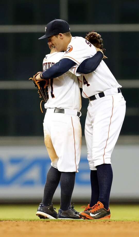 Right fielder George Springer, right, celebrates with second baseman Jose Altuve. Photo: Karen Warren, Houston Chronicle