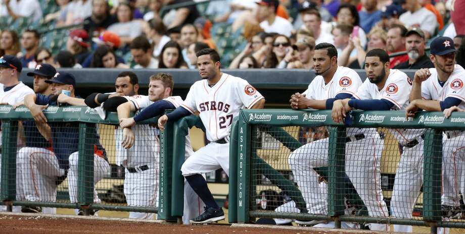 The Astros watch from the dugout during the first inning. Photo: Karen Warren, Houston Chronicle