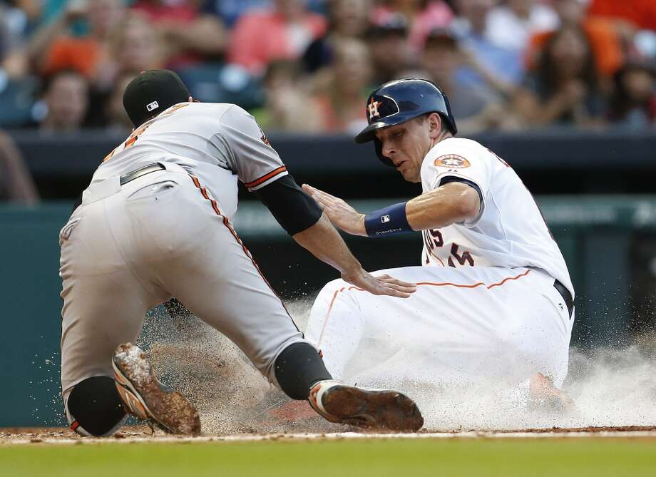 Astros catcher Jason Castro slides into home on a wild pitch. Photo: Karen Warren, Houston Chronicle
