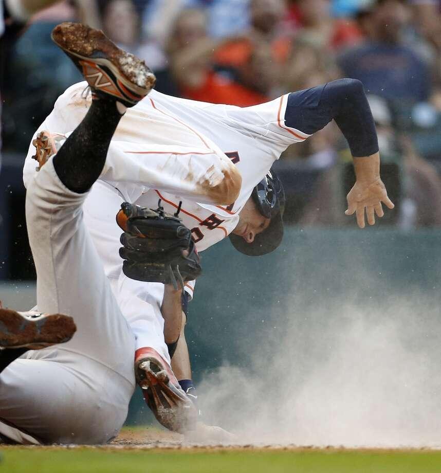 Astros catcher Jason Castro slides into home on a wild pitch. Photo: Karen Warren, Houston Chronicle