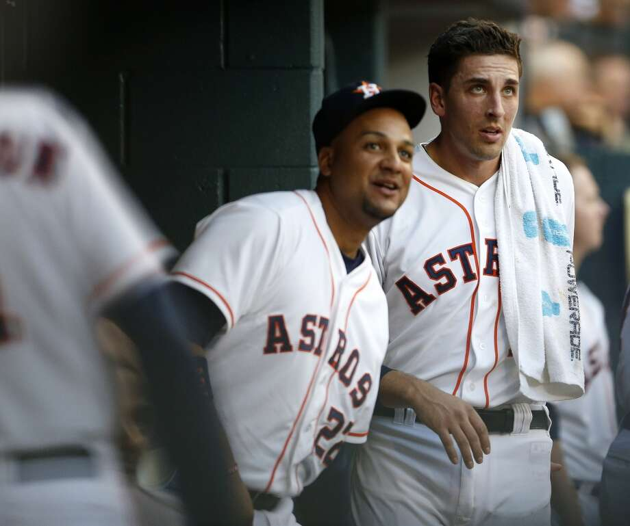 Astros catcher Jason Castro watches the replay from the dugout during a challenge. Photo: Karen Warren, Houston Chronicle