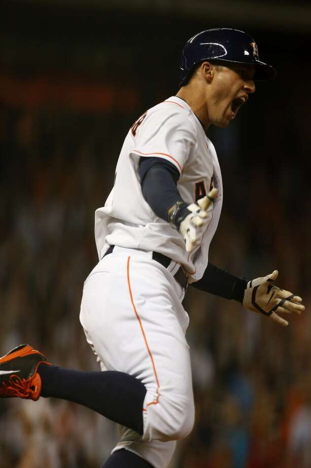 Astros right fielder George Springer reacts after hitting a home run. Photo: Karen Warren, Houston Chronicle