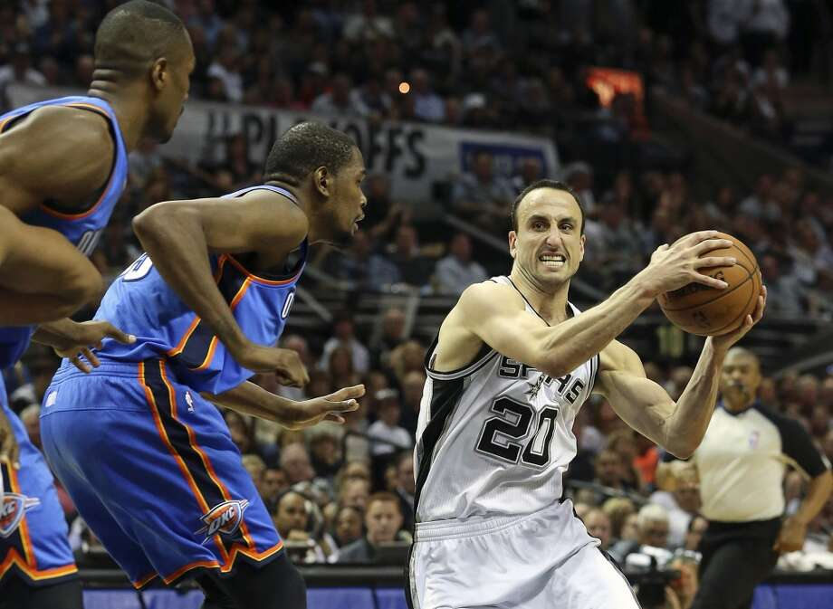 Manu Ginobili moves into the lane against Kevin Durant as the Spurs play the fifth game of the Western Conference Finals against the Oklahoma City Thunder on May 29, 2014.