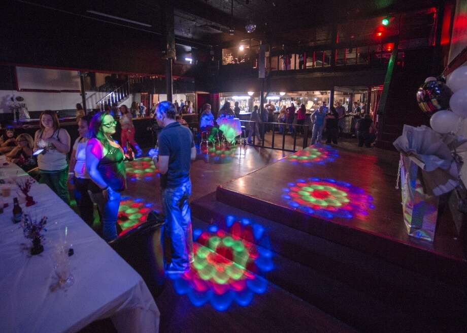 Patrons at the Copa Xclusive talk while multicolored lights move to the music Saturday night. The former Copa bar at Orleans Street and Liberty Avenue has been born anew as the Copa Xclusive, open Saturday nights from 9 pm until 2 am. Photo taken Saturday 5/17/14 Jake Daniels/@JakeD_in_SETX