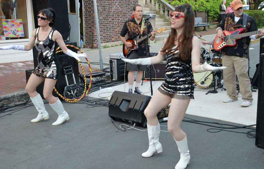 It was Main Street go-go at Thursday's Art About Town street party as dancers grooved to music by The Clams band. Photo: Jarret Liotta / Westport News