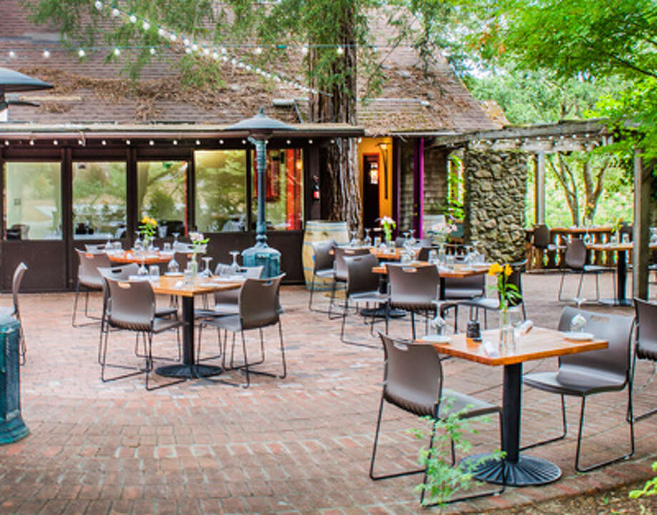 Corks at Russian River Vineyards in Forestville has a tree covered patio befitting its Northern California location. Photo: Courtesy Corks At Russian River Vineyards