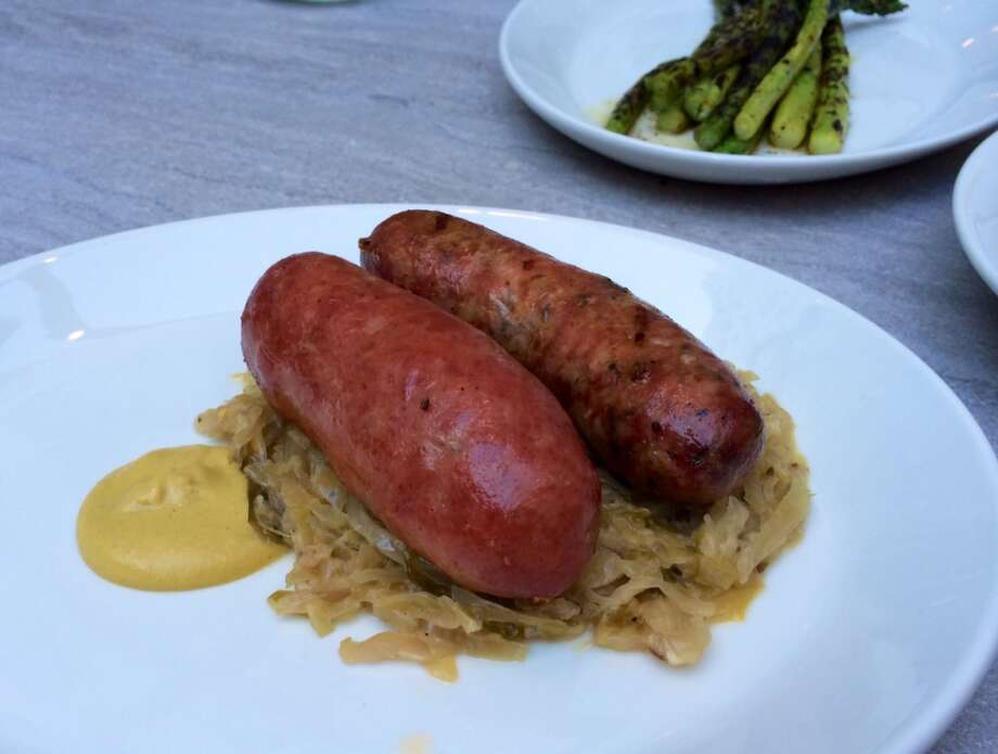 Trou Normand: Bratwurst and basil and fennel sausage on sauerkraut ($20)