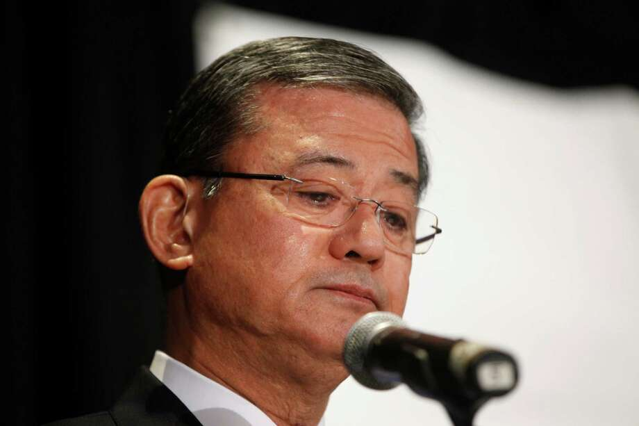 "Veterans Affairs Secretary Eric Shinseki pauses as he speaks at a meeting of the National Coalition for Homeless Veterans, Friday, May 30, 2014, in Washington. President Barack Obama says he plans to have a ""serious conversation"" with Shinseki about whether he can stay in his job. Photo: Charles Dharapak, AP / AP"