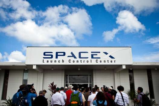 A media tour arrives for a tour of the SpaceX Launch Control Center outside the Cape Canaveral Air Force Station in Florida on Wednesday, July 6, 2011.  ( Smiley N. Pool / Houston Chronicle ) Photo: Houston Chronicle