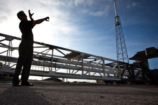 Scott Henderson,  SpaceX Director of Mission Assurance & Integration, gives a tour of  the company's launch pad at the Cape Canaveral Air Force Station in Florida on Wednesday, July 6, 2011.  ( Smiley N. Pool / Houston Chronicle ) Photo: Houston Chronicle