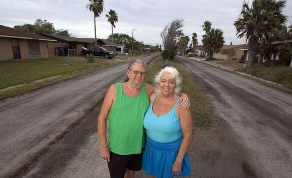 Terry Heaton left, and his wife Bonnie Heaton residents of Kopernik Shores neighborhood near Boca Chica Beach stands in front of the Weems street which is the the main street in the neighborhood near the proposed site for SpaceX spaceport Tuesday, June 19, 2012, in Brownsville. The Heaton's are opposed to the proposed spaceport. ( James Nielsen / Chronicle ) Photo: Houston Chronicle