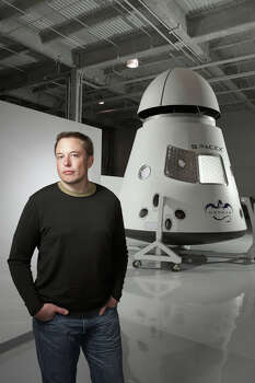 Elon Musk, founder and chief executive officer of SpaceX, stands with one of the company's space capsules on March 13, 2008. Musk, co-founder of payment giant PayPal Inc., was flying back empty handed from Moscow for a third time in November 2001, when the idea for his new company hit him. Photographer: Markham Johnson/Bloomberg Markets via Bloomberg News Photo: MARKHAM JOHNSON, VIA BLOOMBERG NEWS / BLOOMBERG MARKETS