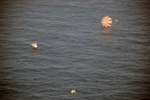 In this image provided by SpaceX, recovery boats approach the Dragon capsule after splashdown in the Pacific Ocean off the coast of Mexico's Baja Peninsula. The vehicle brought back more than 1 ton of science experiments and old equipment from the International Space Station. It's the only supply ship capable of two-way delivery. NASA is paying SpaceX more than $1 billion for a dozen resupply missions. (AP Photo/SpaceX) Photo: Associated Press
