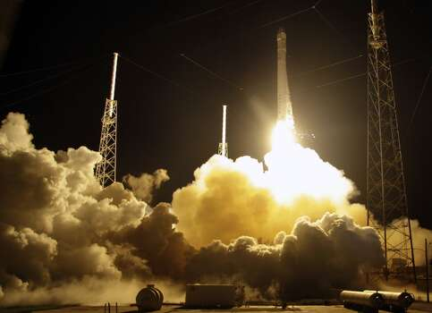 The Falcon 9 SpaceX rocket lifts off from space launch complex 40 at the Cape Canaveral Air Force Station in Cape Canaveral, Fla. on Sunday, Oct. 7, 2012. The rocket is carrying supplies to the International Space Station. (AP Photo/Terry Renna) Photo: Associated Press