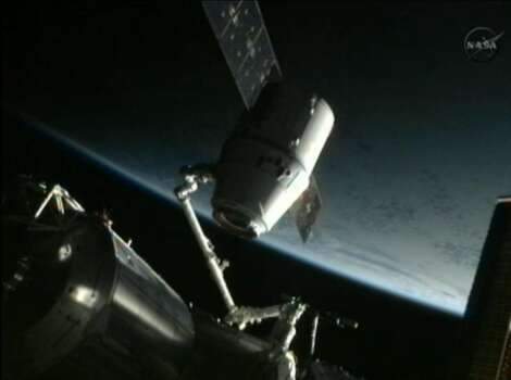 This framegrab image from NASA-TV shows the SpaceX Dragon capsule just after the capsule is backed away from the International Space Station and being repositioned for release later Thursday morning May 31, 2012. The Dragon capsule is scheduled for splashdown at 11:44 a.m. EDT Thursday in the Pacific Ocean. (AP Photo/NASA) Photo: Associated Press
