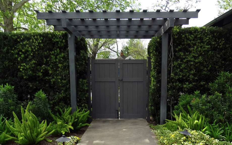 A simple arbor provides a shaded entry to the garden. Photo: Picasa