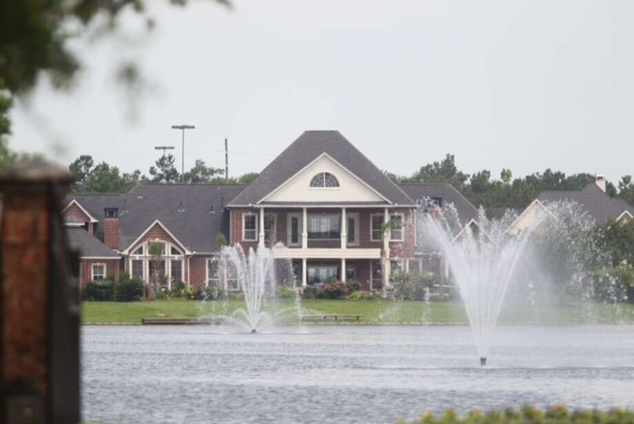 A couple was fatally shot Thursday in their home in a gated community in Katy. Photo: Cody Duty / Houston Chronicle