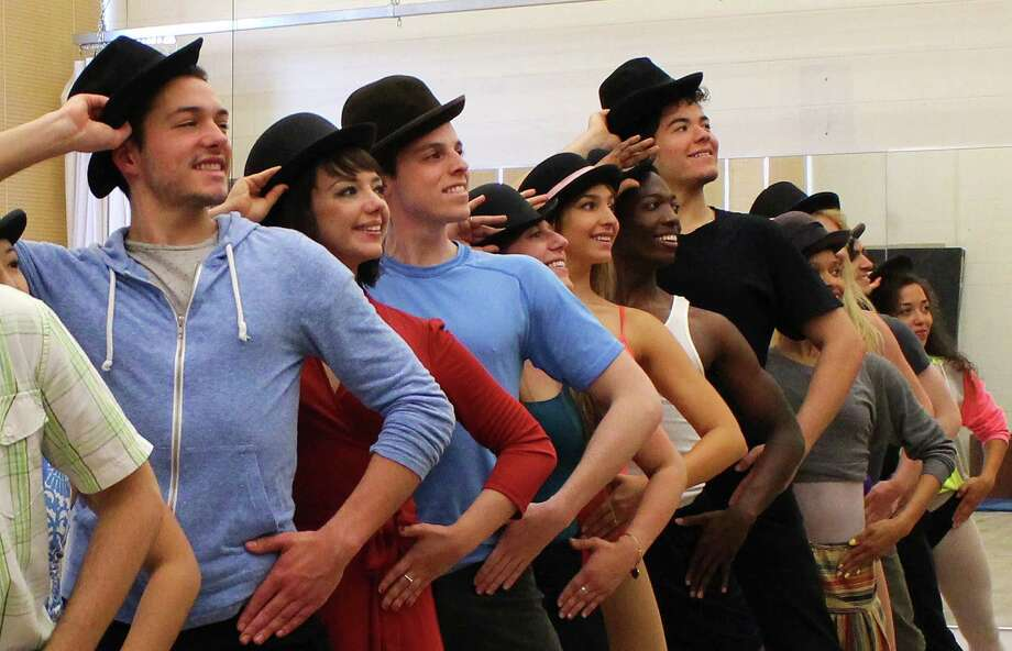 "(Left to right) Stephen Brower, Lori Ann Ferreri, Ethan Kasnett, Angela Millin, Amandina Altomare, Johnny Brantley III, Gabriel Bernal, Khetanya Henderson and Alanna Saunders work to be a part of ""the line"" onstage in ""A Chorus Line"" at Connecticut Repertory Theatre in Storrs from June 5 to 14. Photo: Contributed Photo / Connecticut Post"