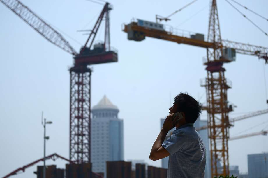 A construction site in Beijing, one of the cities that has been transformed by decades of unbridled economic growth. Photo: Wang Zhao, AFP/Getty Images