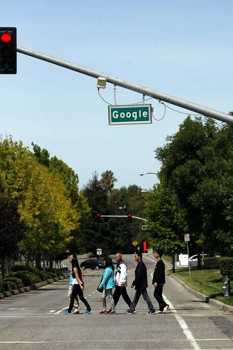A group of tourists crosses Charleston Rd. under a Google street sign on the Googleplex campus in Mountain View, CA, Saturday May 24, 2014. Photo: Michael Short, The Chronicle