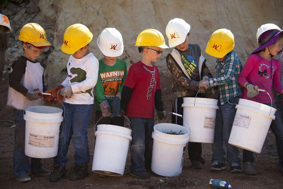 I guess we can cross mulch transport off our bucket list:A volunteer construction crew of first-graders from   Colorado Springs, Colo., form a bucket brigade to carry mulch to be spread over a burn area of   the 2012 Waldo Canyon Fire. Photo: Mark Reis, Associated Press