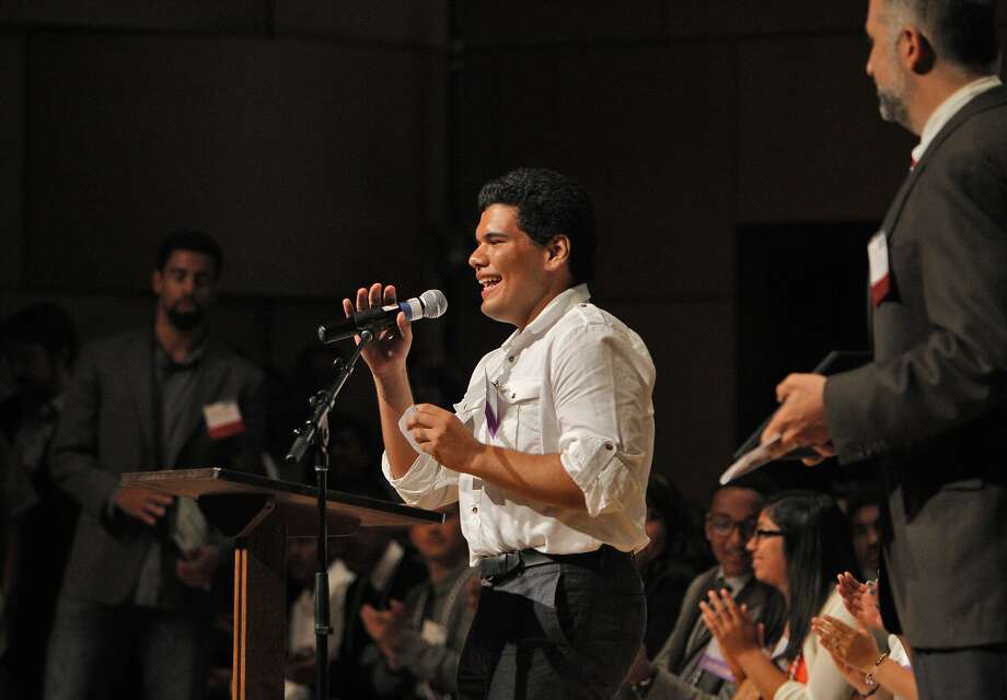 Jose Santacruz, one of 50 students chosen this year to receive help from East Bay College Fund, shares his goals at a ceremony at Mills College in Oakland. Photo: Carlos Avila Gonzalez, The Chronicle