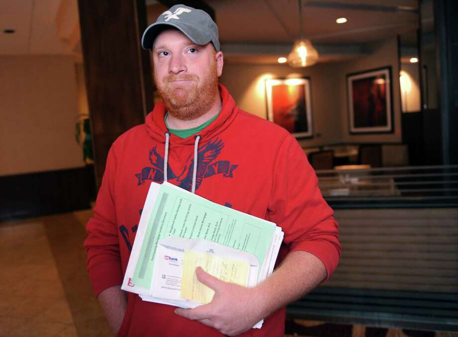 James Csonka, of Ansonia, talks about his experience after attending a state-sponsored mortgage assistance event at the Marriott in Trumbull Friday, May 30. 2014. Connecticut homeowners got an opportunity to explore loan modification and foreclosure prevention options with their lenders at the day-long event. Photo: Autumn Driscoll / Connecticut Post