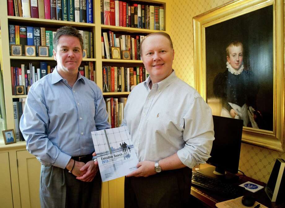 Scott Scanlon, left, and Christopher Hunt, right, of HSZ Media pose for a photo with their 2013 Executive Search State of the Industry Report on Thursday, May 29, 2014. This year's version of the report came out this month. Photo: Lindsay Perry / Stamford Advocate